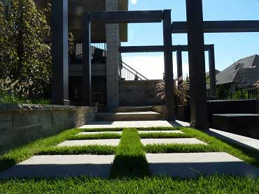 Stepping stones set in sod leading to the pergola in Kitchener