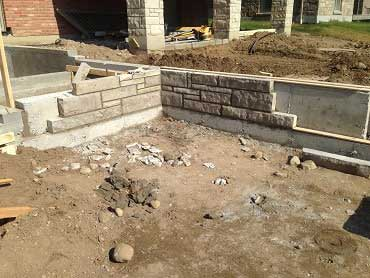 Build photo of the retaining wall and patio