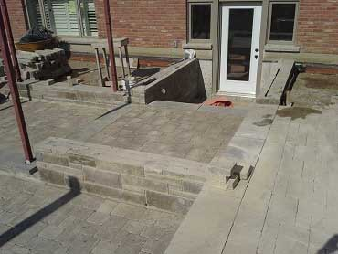 Build photo of the patio and natural stone retaining wall